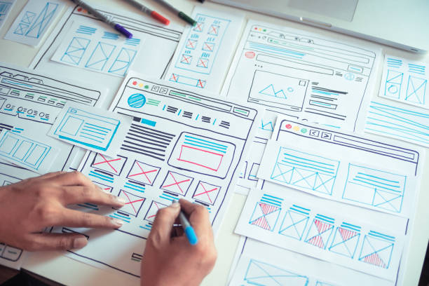 Website designer Creative planning application developer development draft sketch drawing template layout prototype framework wireframe design studio . User experience concept . stock photo