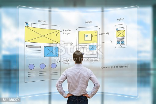 istock Website front end designer reviewing wireframe layout mockup, AR screen 844488274