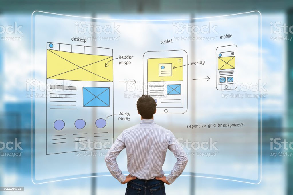 Website front end designer reviewing wireframe layout mockup, AR screen stock photo