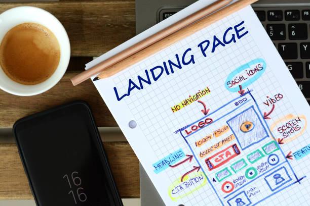website, landing page entwicklung – skizze auf mathe buch - startseite stock-fotos und bilder