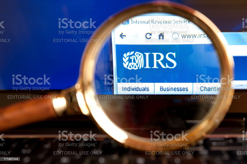 IRS website through a magnifying glass stock photo