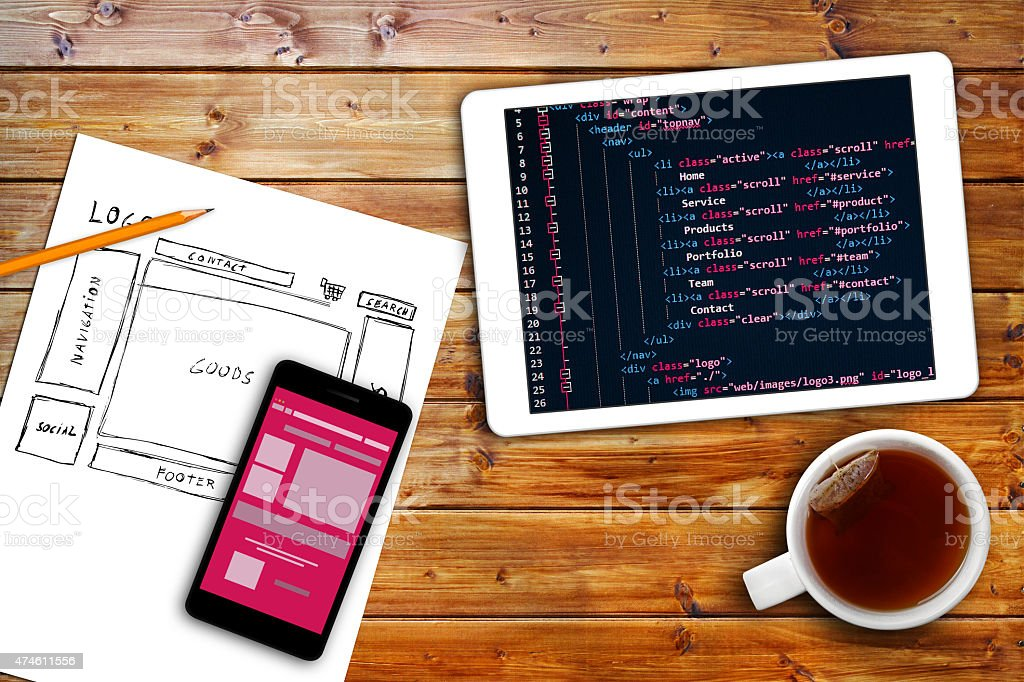 website wireframe sketch and programming code on digital tablet - Royalty-free 2015 Stock Photo