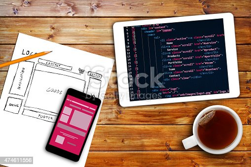 istock website wireframe sketch and programming code on digital tablet 474611556