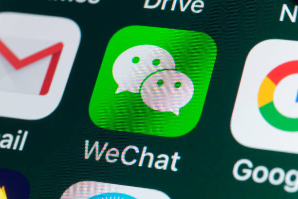 wechat, google, gmail and other apps on iphone screen - gmail imagens e fotografias de stock