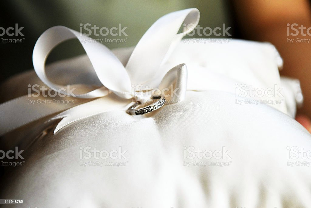 Weddding Ring on Pillow with Ribbon royalty-free stock photo