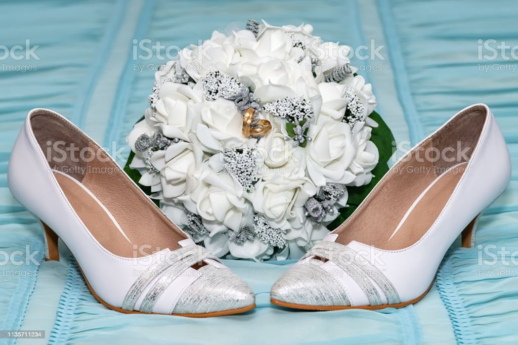 Wedding accessories. Two wedding rings in a bridal bouquet and bridal...