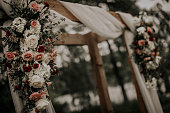 Outside wedding ceremony with flowers and linen