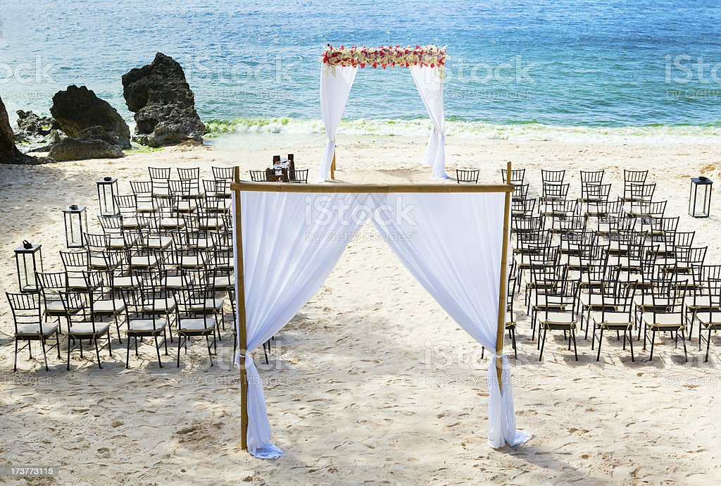 Wedding arch and chairs on the beach royalty-free stock photo
