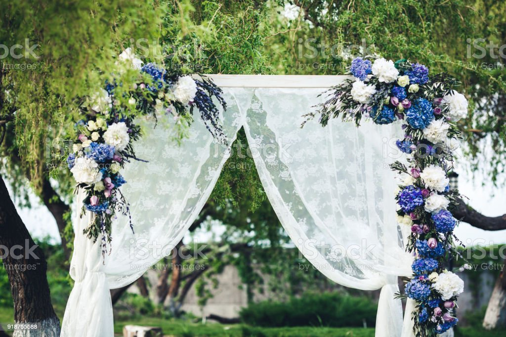 Wedding Arch Decorated With Fabric And Flowers Stock Photo More