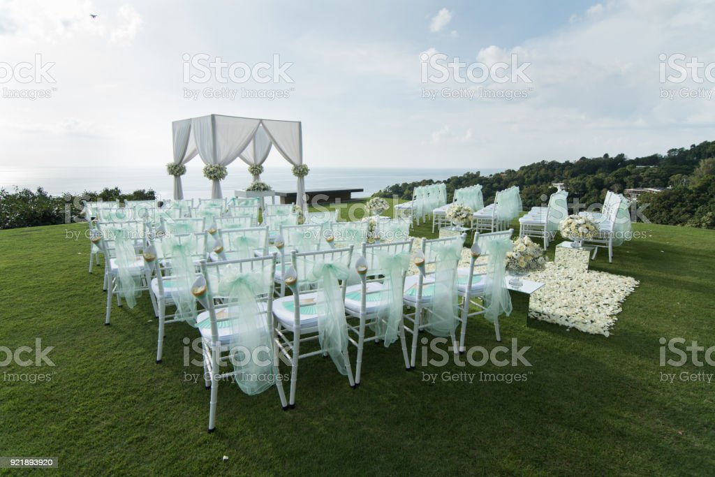 Wedding Arch Decorated With White And Green Flowers Outdoors