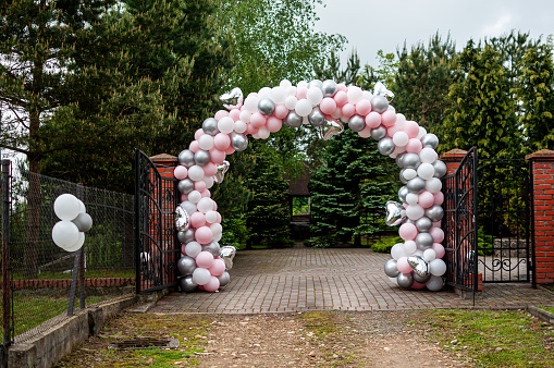 Wedding arch made of colorfull inflatable balloons
