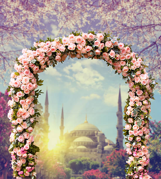 wedding arch with blue mosque at sunset stock photo