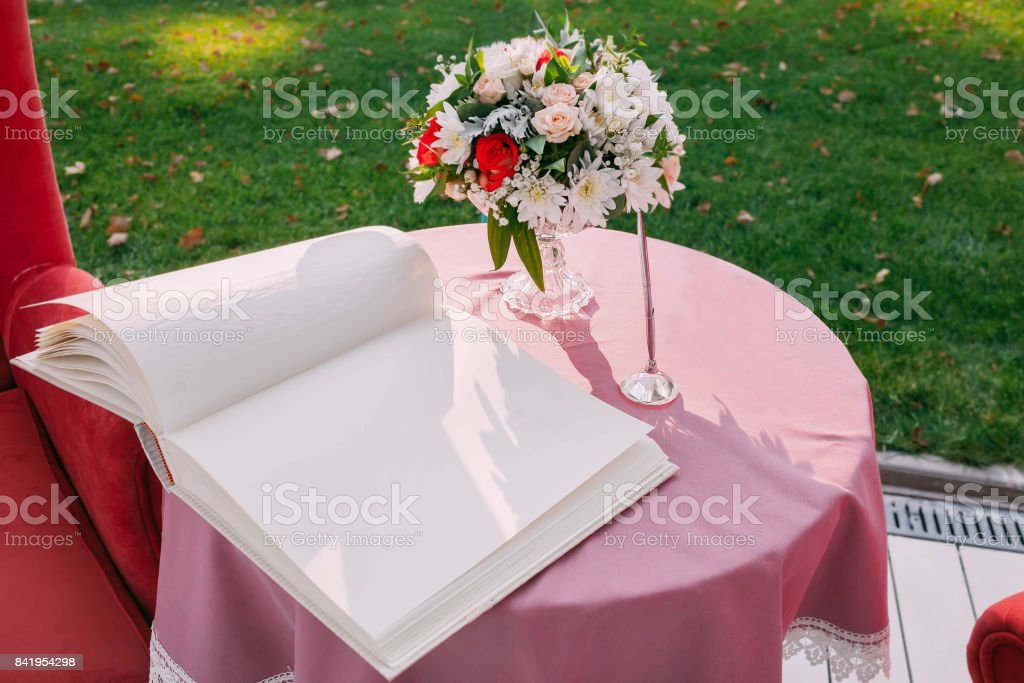 Wedding Area Decorated With An Open Empty Book And Flowers