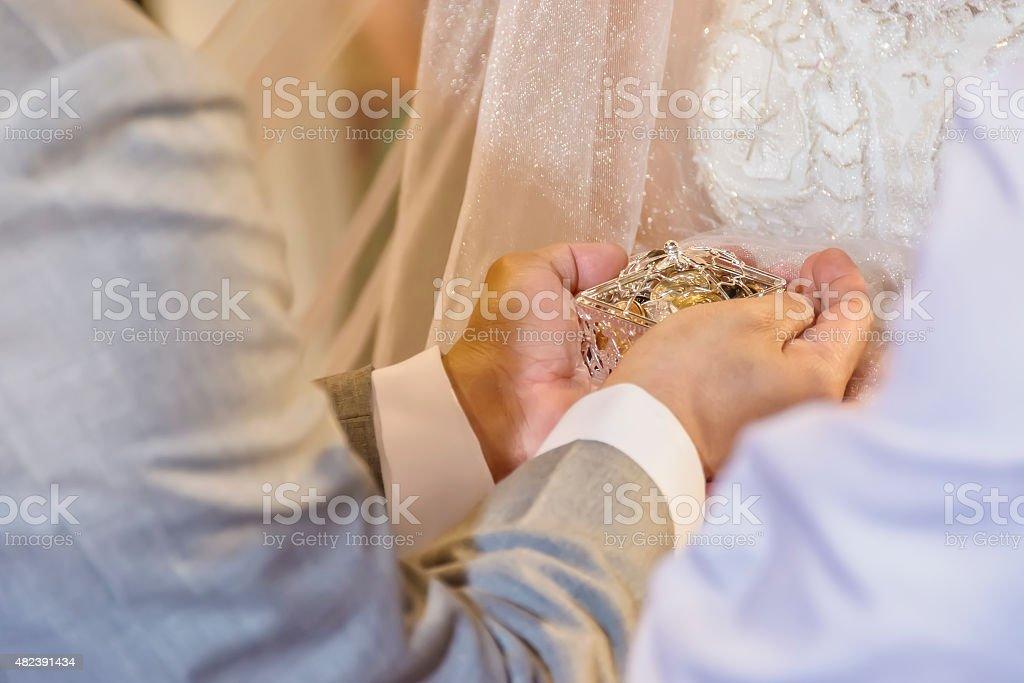 Wedding Arras, Groom, Bride stock photo