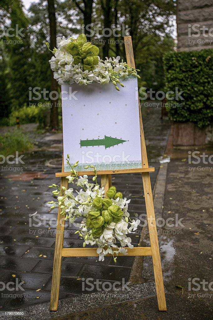 Wedding  arrow Sign and  wooden easel royalty-free stock photo