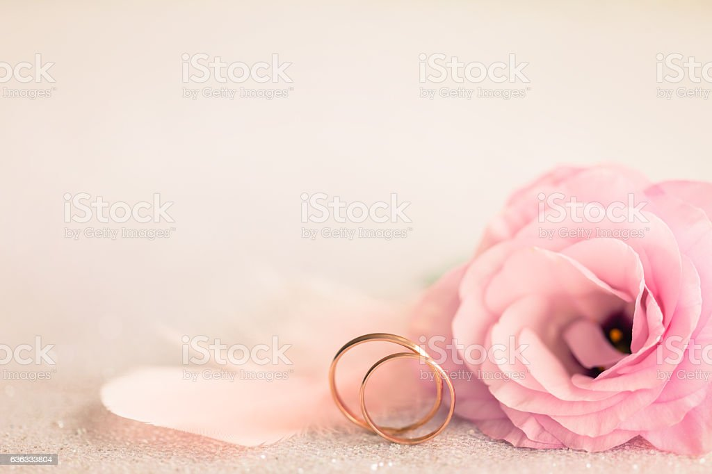 Wedding Background With Gold Rings Gentle Flower And Light Pin Stock