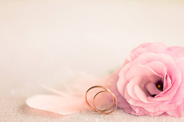 wedding  background with gold rings, gentle flower and light pin - heiratsantragsring stock-fotos und bilder