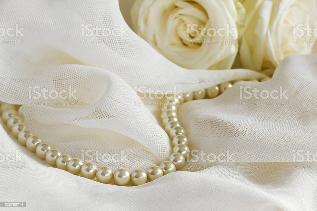 Wedding background with pearl beads and roses stock photo