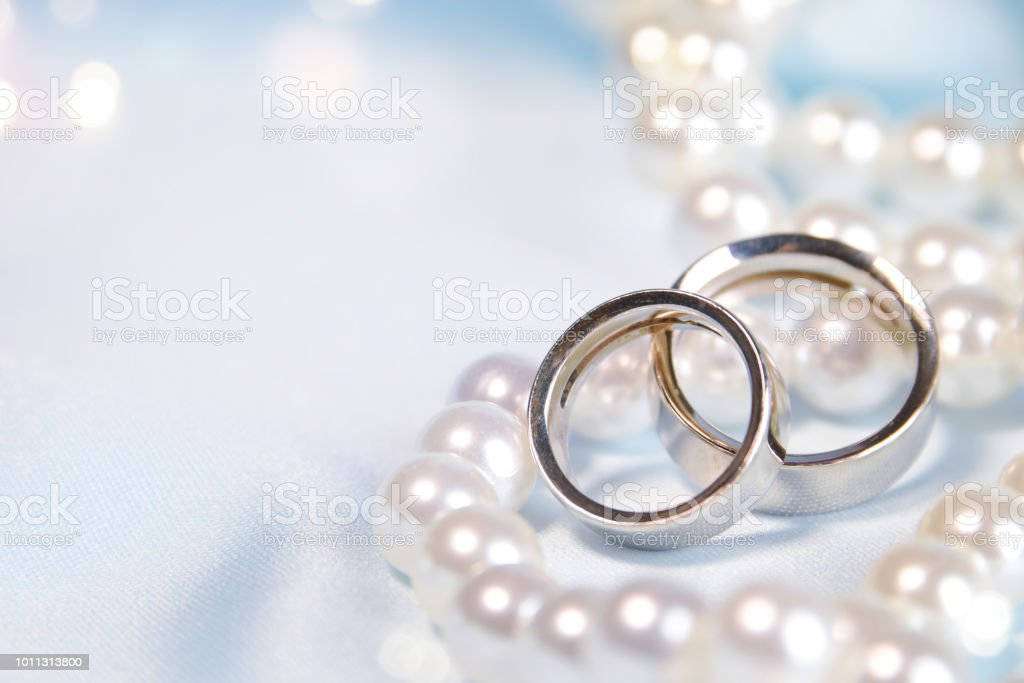 Wedding Background With Rings And Pearls Stock Photo - Download Image Now
