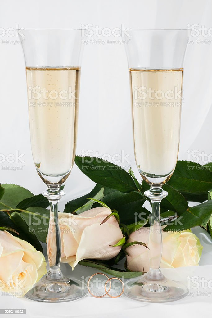 Wedding background with two glasses of champagne, ring and rose stock photo