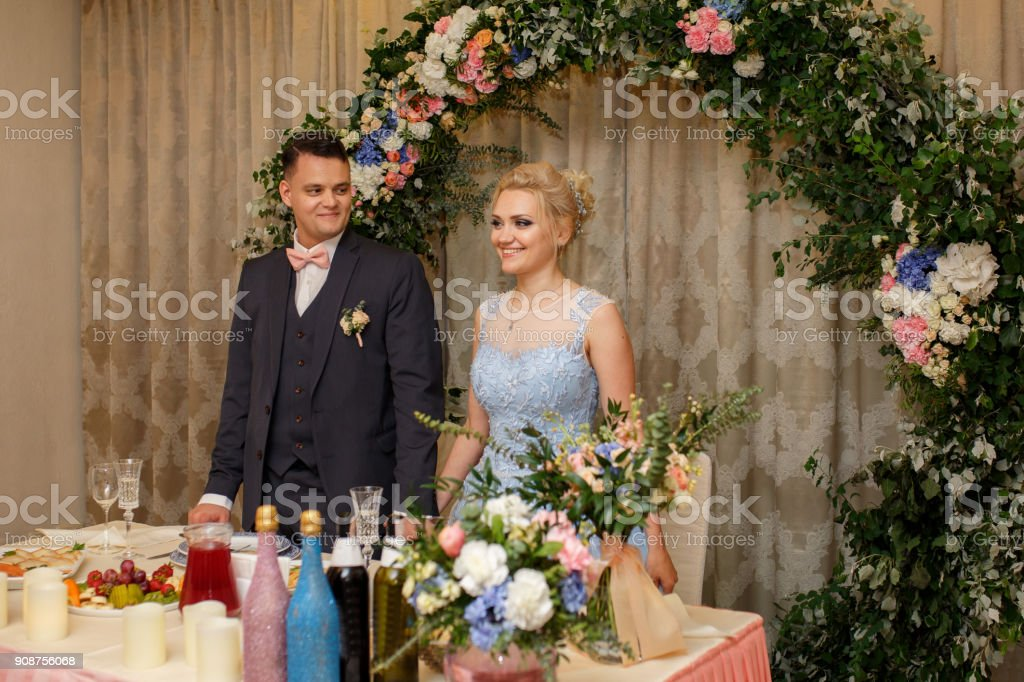 Wedding Banquet Wedding Dinner And Reception In Restaurant Bride And Groom On Rustic Wedding Arch Background Stock Photo Download Image Now Istock