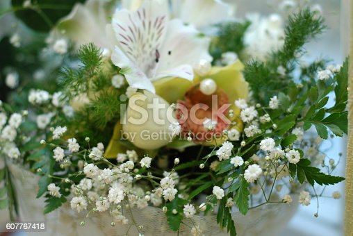 Wedding bouquet from soft and light flowersWedding bouquet and young man in suit at back