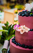 Flowers, berries on the cake, wedding table
