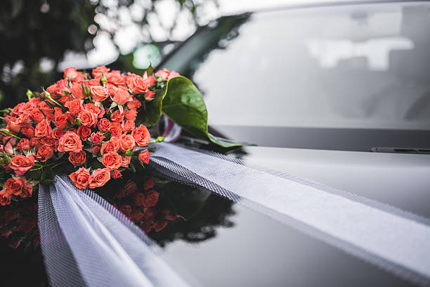 Wedding bouquet and bridal car stock photo