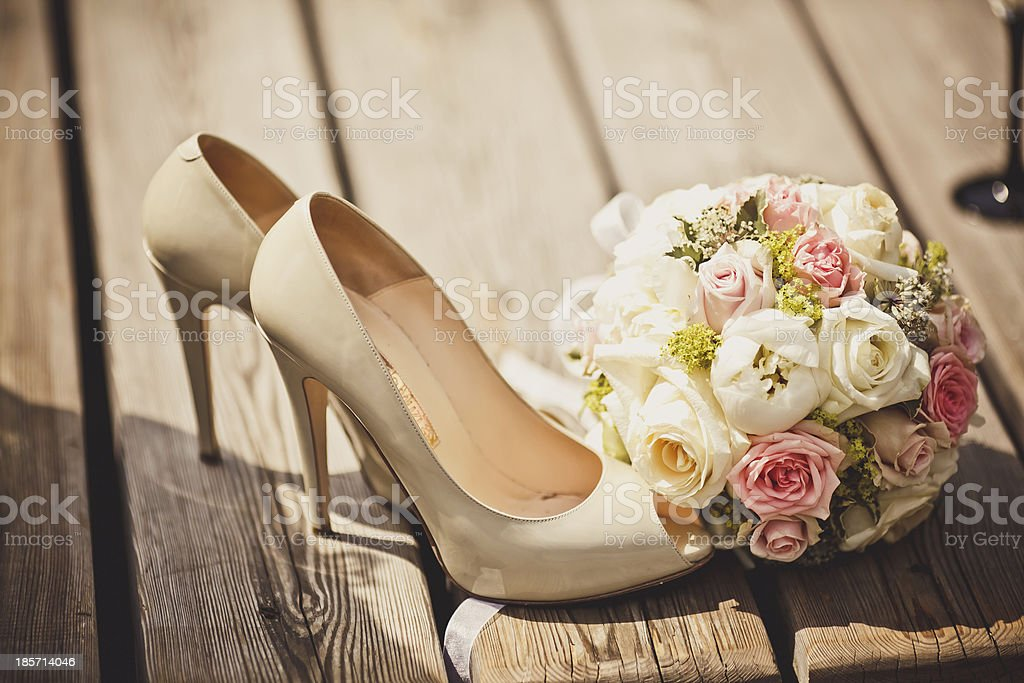 Wedding bouquet and bride shoes royalty-free stock photo