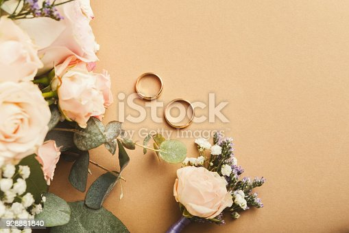 istock Wedding bouquet and gold rings, closeup 928881840