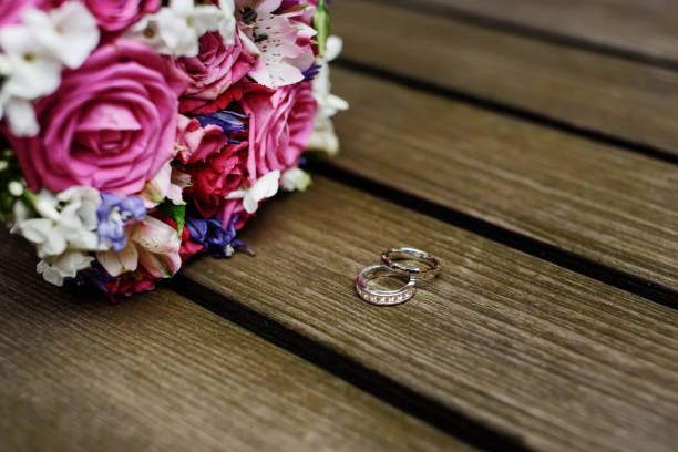 Wedding bouquet and wedding rings. stock photo