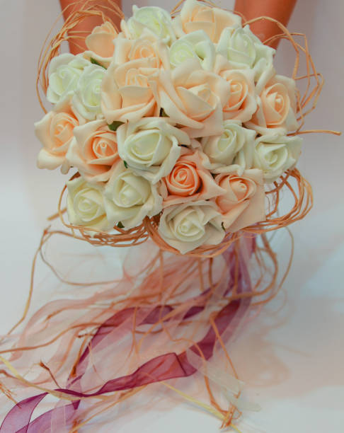 wedding bouquet cream and pale pink roses stock photo