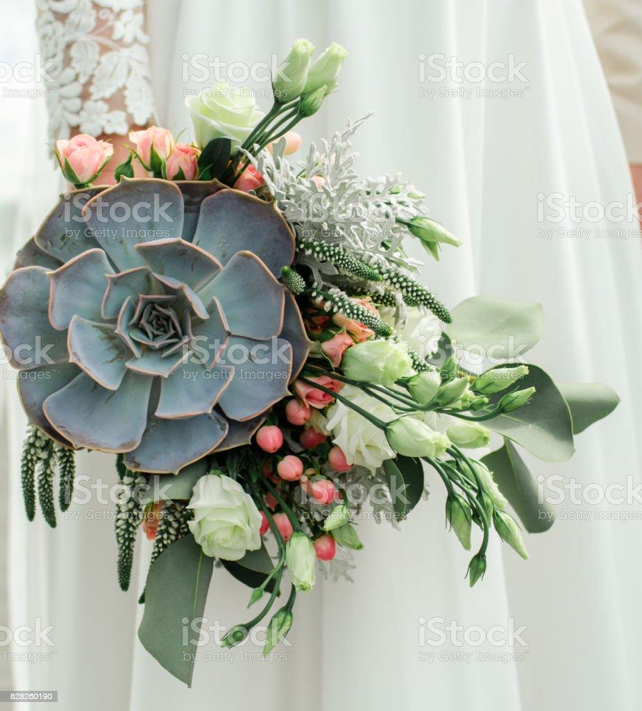 Wedding bouquet, exclusive, rich design Bride holding the wedding bouquet, close-up stock photo
