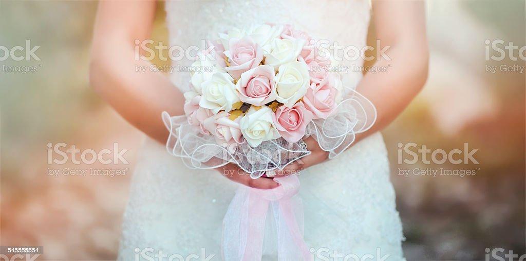 Wedding bouquet in hands of the bride stock photo