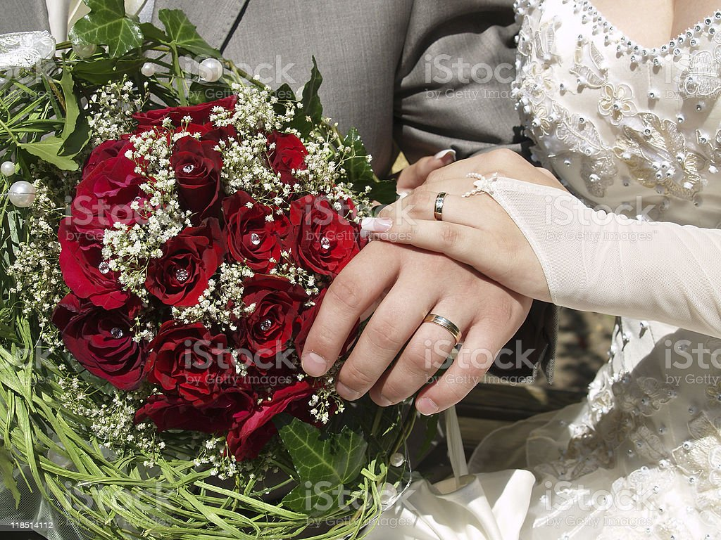 Wedding bouquet in hands royalty-free stock photo