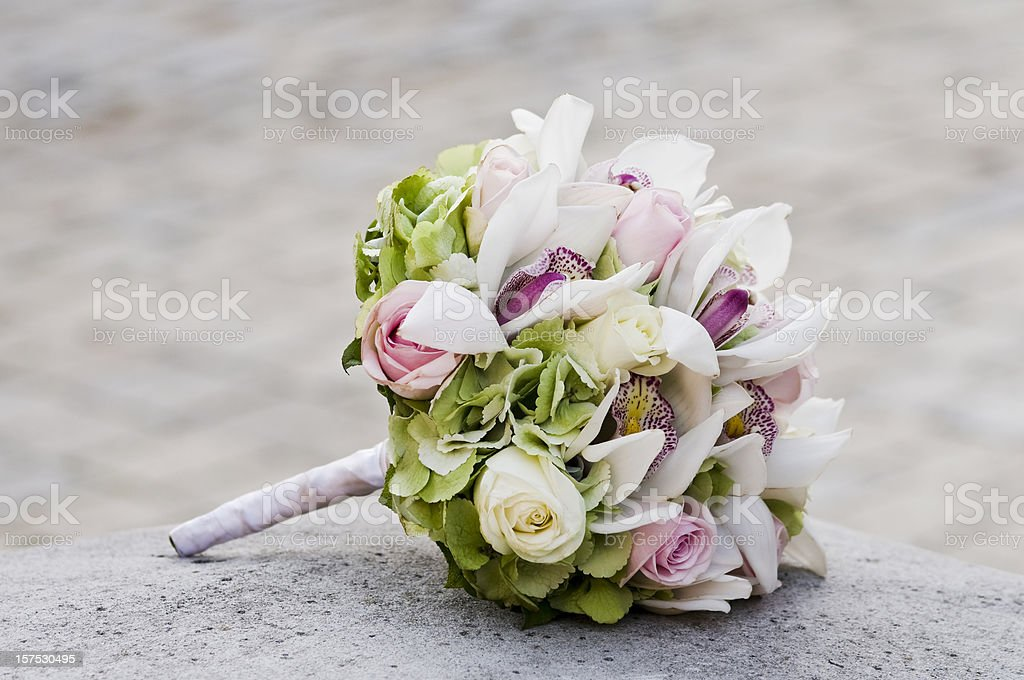Wedding Bouquet laying on stone block stock photo