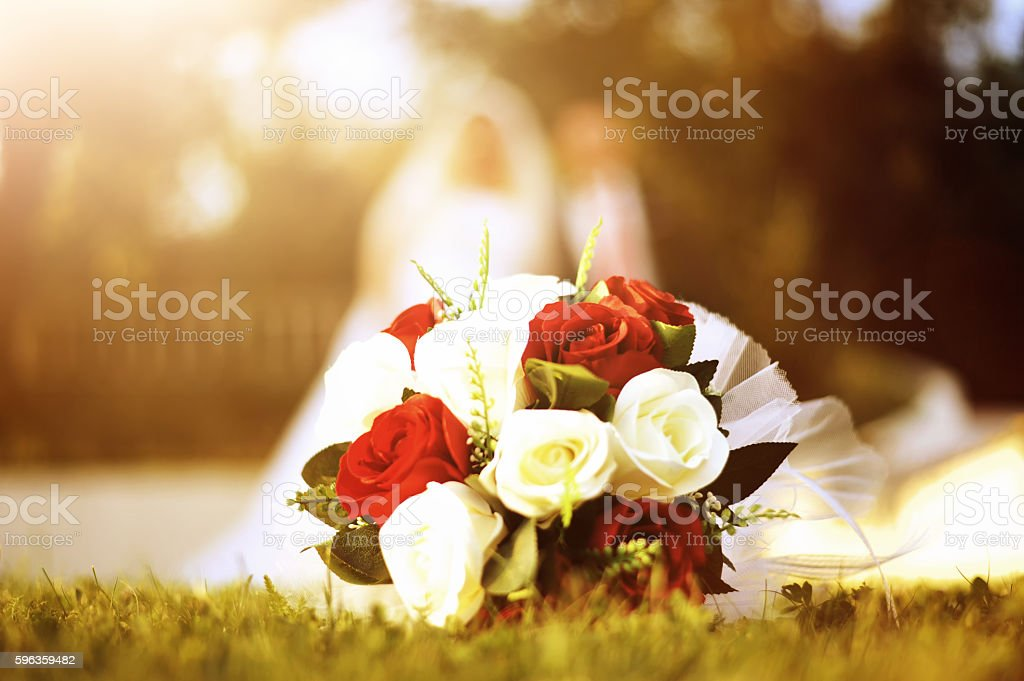 wedding bouquet laying on the grass royalty-free stock photo