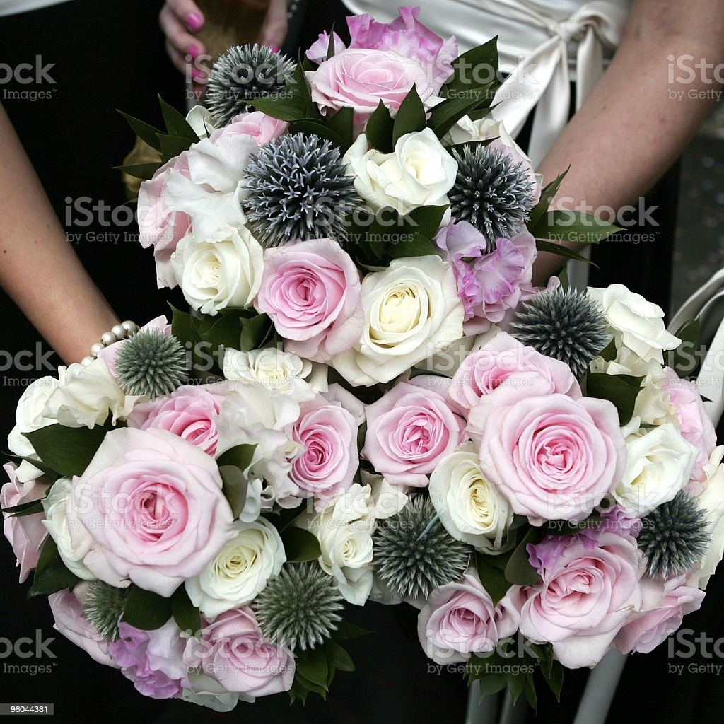 wedding bouquet of roses and thistles royalty-free stock photo