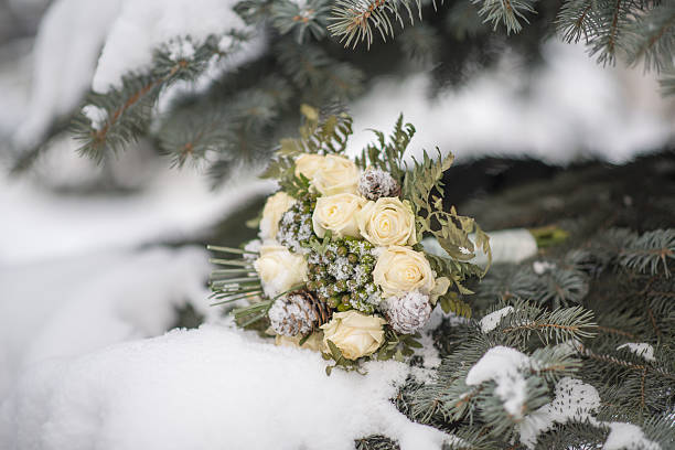 Wedding bouquet on a snow branch. stock photo