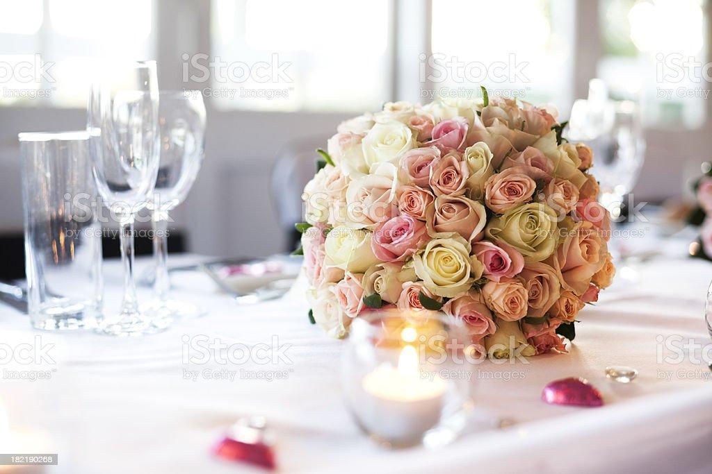 A wedding bouquet on a wedding reception table