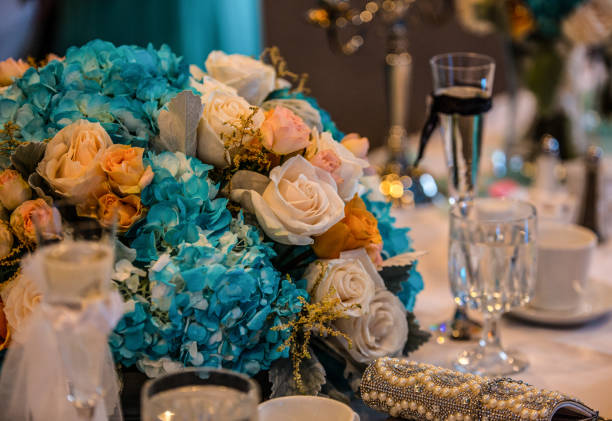 Wedding Bouquet on table with glasses and coffee cups stock photo