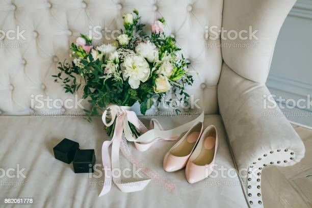 Wedding bouquet pink bridal shoes and black boxes with rings on a picture id862061778?b=1&k=6&m=862061778&s=612x612&h=oaqetg1tnvieaoyyqbjinzzb50sxeqo2m gfcqi w m=