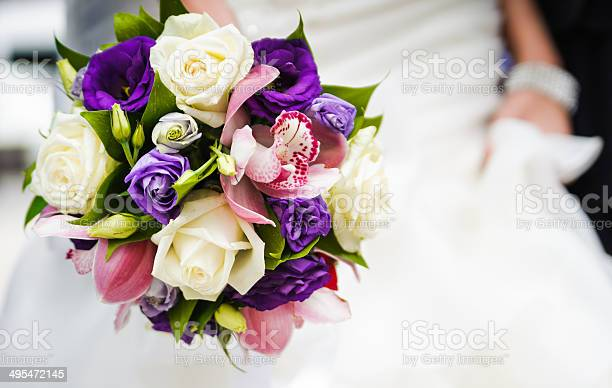 Wedding bouquet with different flowers in hands of bride picture id495472145?b=1&k=6&m=495472145&s=612x612&h=crh1vtapdzrbmgogh uybuumfqadmhjbvhv5clwmyqu=