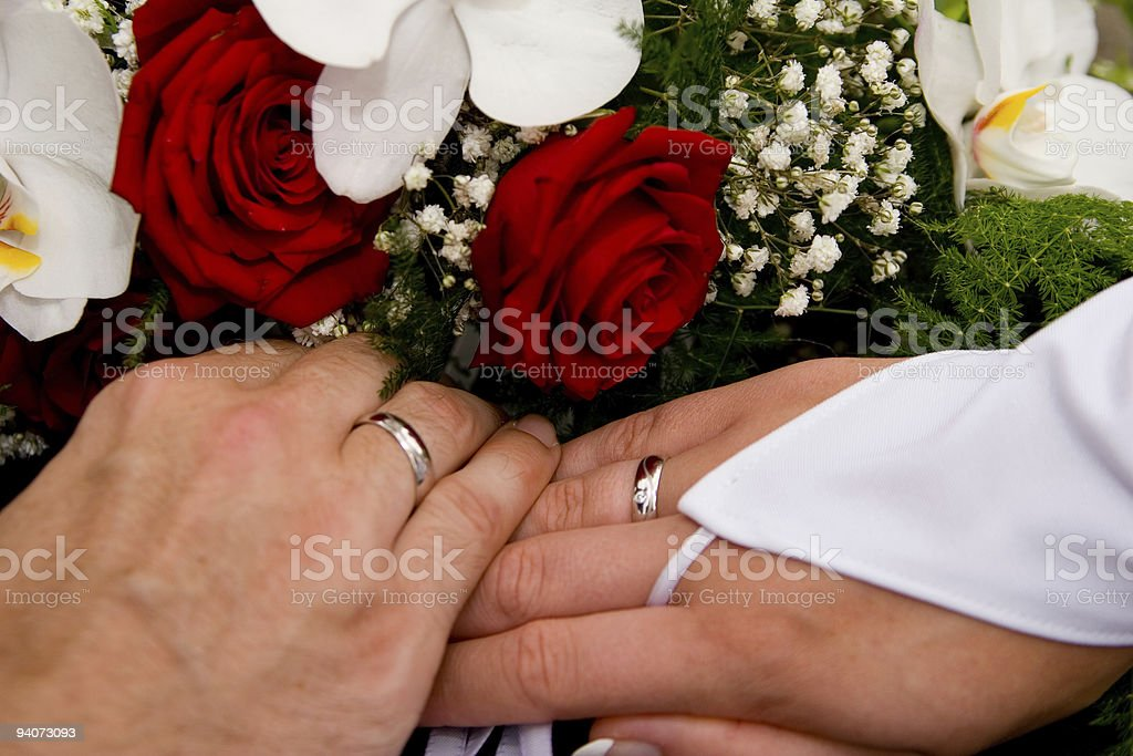 Wedding Bouquet with hands and rings royalty-free stock photo