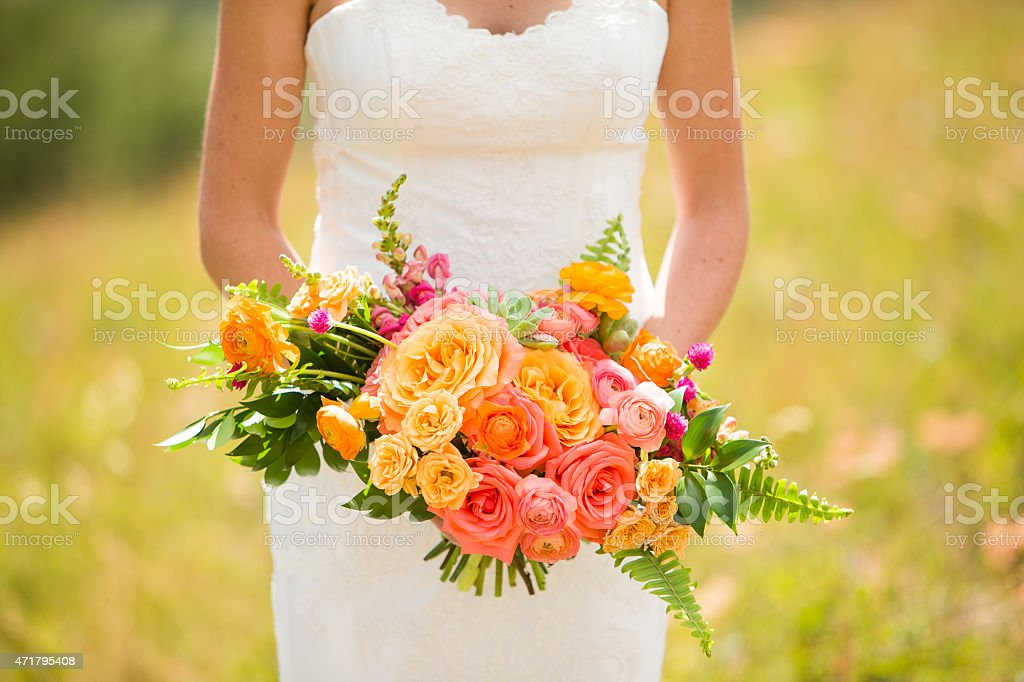 Wedding bouquet with Roses, Ranunculus, Snap Dragons, Gomphrena, and Echeveria stock photo