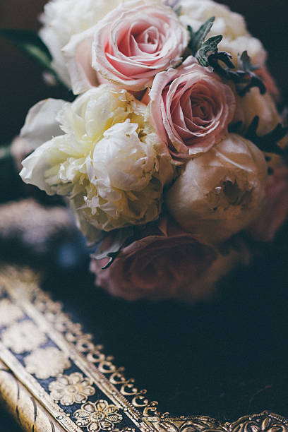 Wedding bouquette and roses stock photo