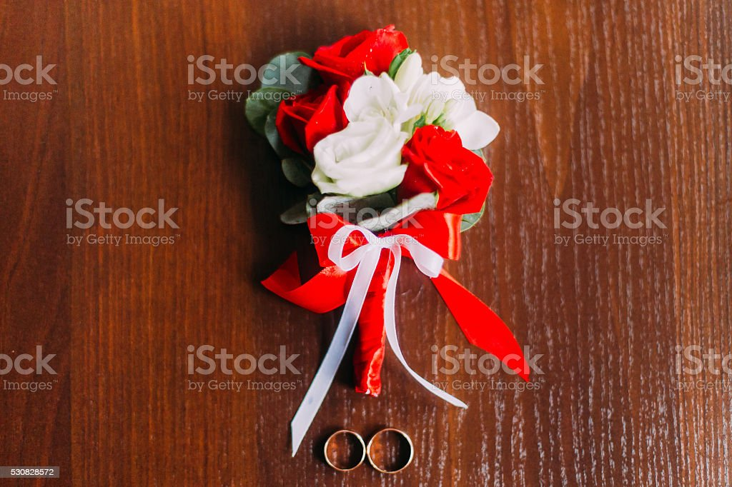 Wedding boutonniere on wooden background in rustic style stock photo