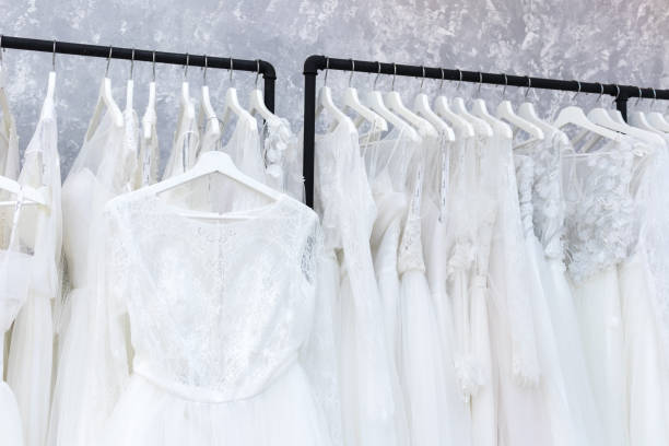 Wedding bride dress in the salon fitting room stock photo