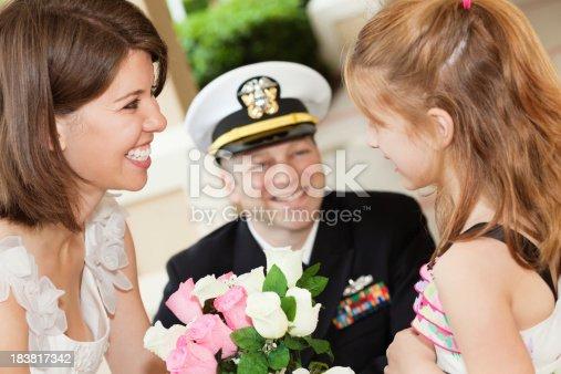 674214372istockphoto Wedding Bride Talking With Flower Girl 183817342