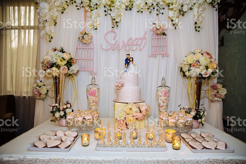 Wedding cake and candy bar. Table with sweets stock photo